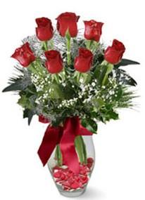 Bursadaki çiçekçi bursaya çiçek  7 adet kirmizi gül cam vazo yada mika vazoda